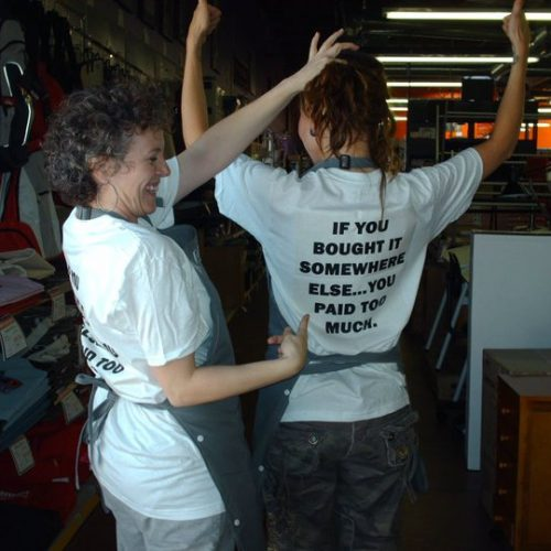 Two Staff Members of Jerry's Artarama Art Supply Store in Tempe, AZ Show Off Their Custom T-Shirts