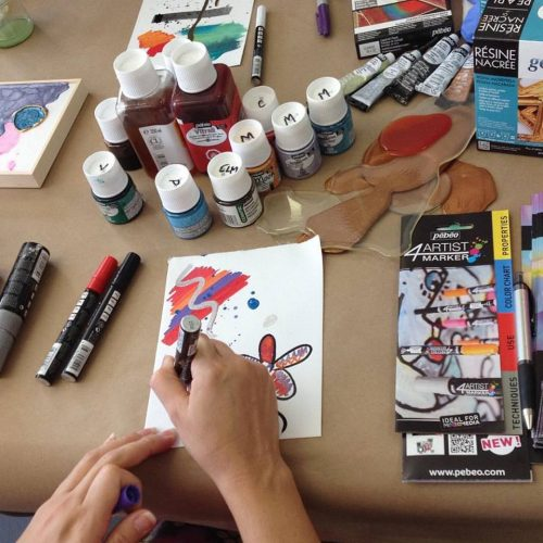 An Artist Draws with Metallic Markers at Jerry's Artarama of West Palm Beach, FL