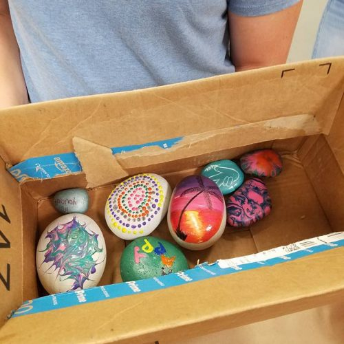 An Artist Shows Off Her Painted Eggs in Jerry's Artarama of West Palm Beach, FL
