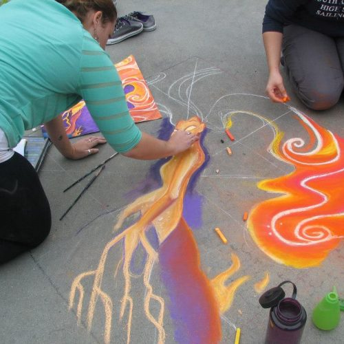 An Artist Drawing with Sidewalk Chalk at Jerry's Artarama of Providence, RI