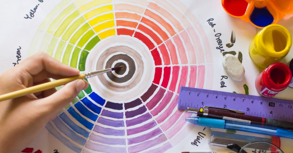 handmade color wheel with drawing and art supplies